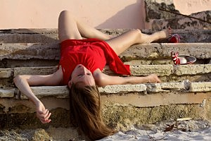unconscious woman  on the stairs