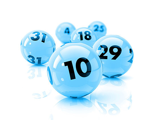 Six lottery balls on a white reflective table