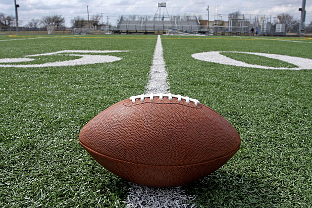 American Football on Outdoor Field at the 50 Yard Line