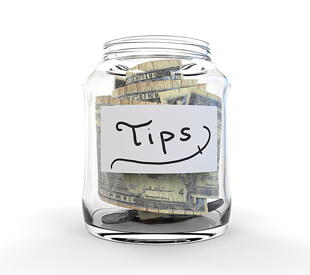 Jar for Tips with Money isolated on white background. 3D render